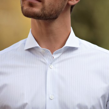 White cutaway collar shirt with widely spaced blue pinstripes